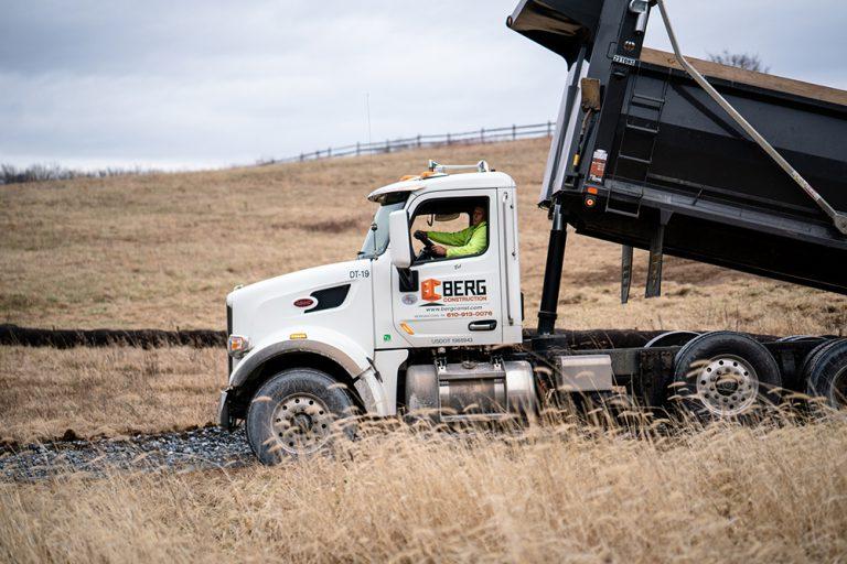 Berg Construction Dump Truck Elevated to Dump Contents at a Job Site