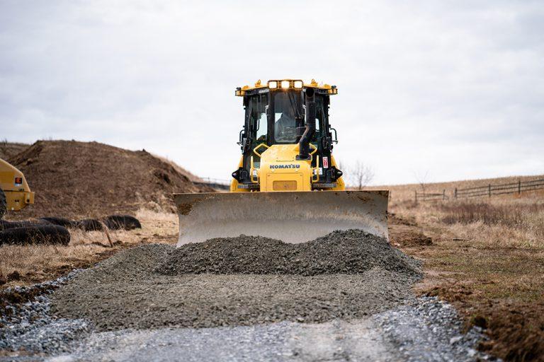 Komatsu Bulldozer Pushing Gravel at a Job Site
