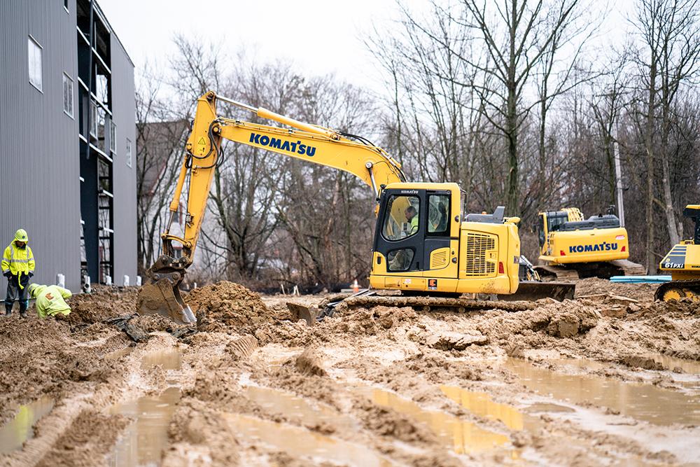 Komatsu Excavator Working on a Muddy Job Site