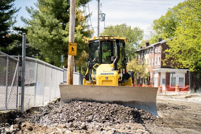 Komatsu Bulldozer Pushing Gravel into a Pile on a Road Repavement Project
