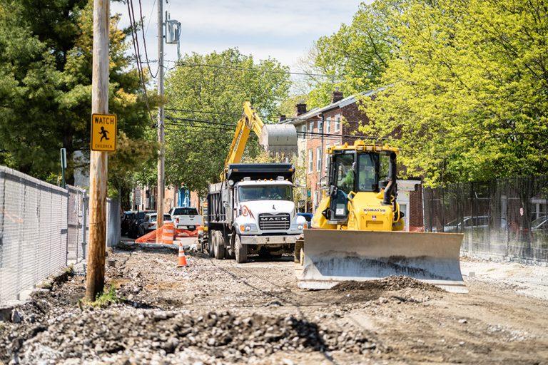 Komatsu Bulldozer, Dump Truck and Excavator Working on a Road Repavement Project