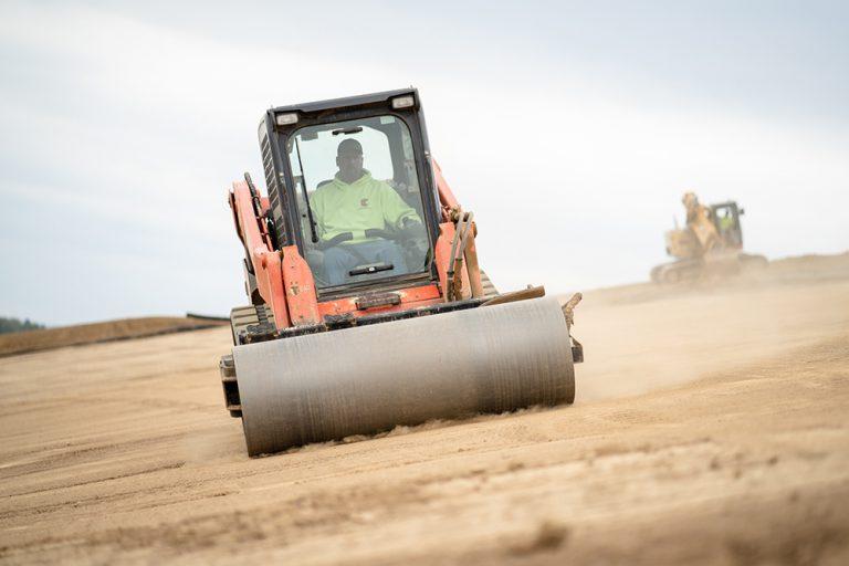 Berg Waste Management Team Member Operating a Kabota Roller at a Pennsylvania Landfill